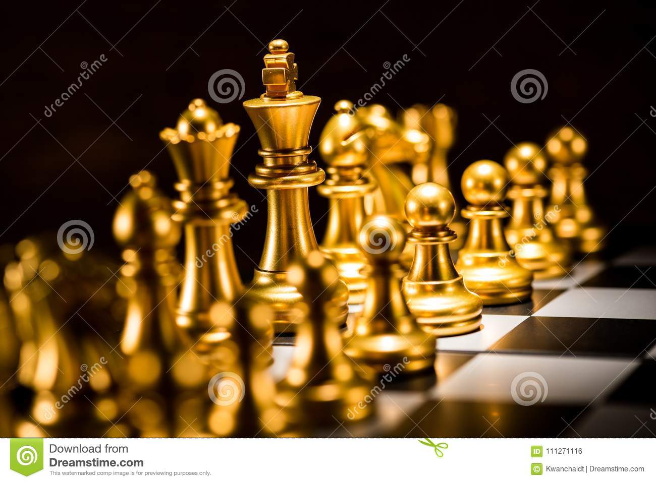 Gold Chess Pieces Gold Chess Pieces On A Chessboard Business Strategy Concept Stock