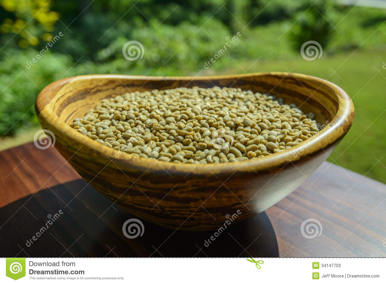 Unroasted Organic Arabica Coffee Beans Green Unroasted Coffee Beans In A Bamboo Bowl Stock Photos