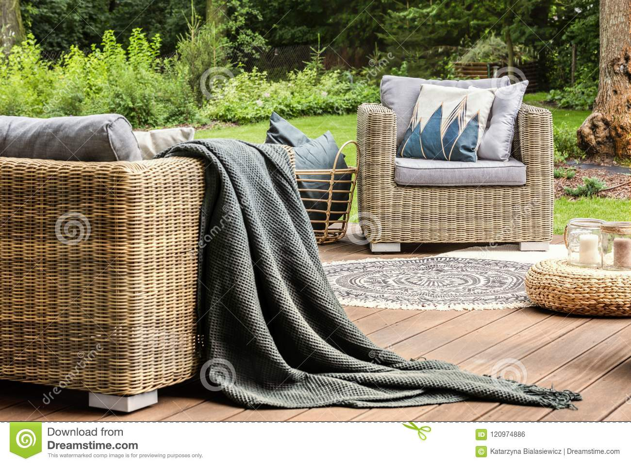 Rattan Sofa Near Me Grey Blanket On Rattan Sofa Near Armchair With Pillows On Wooden