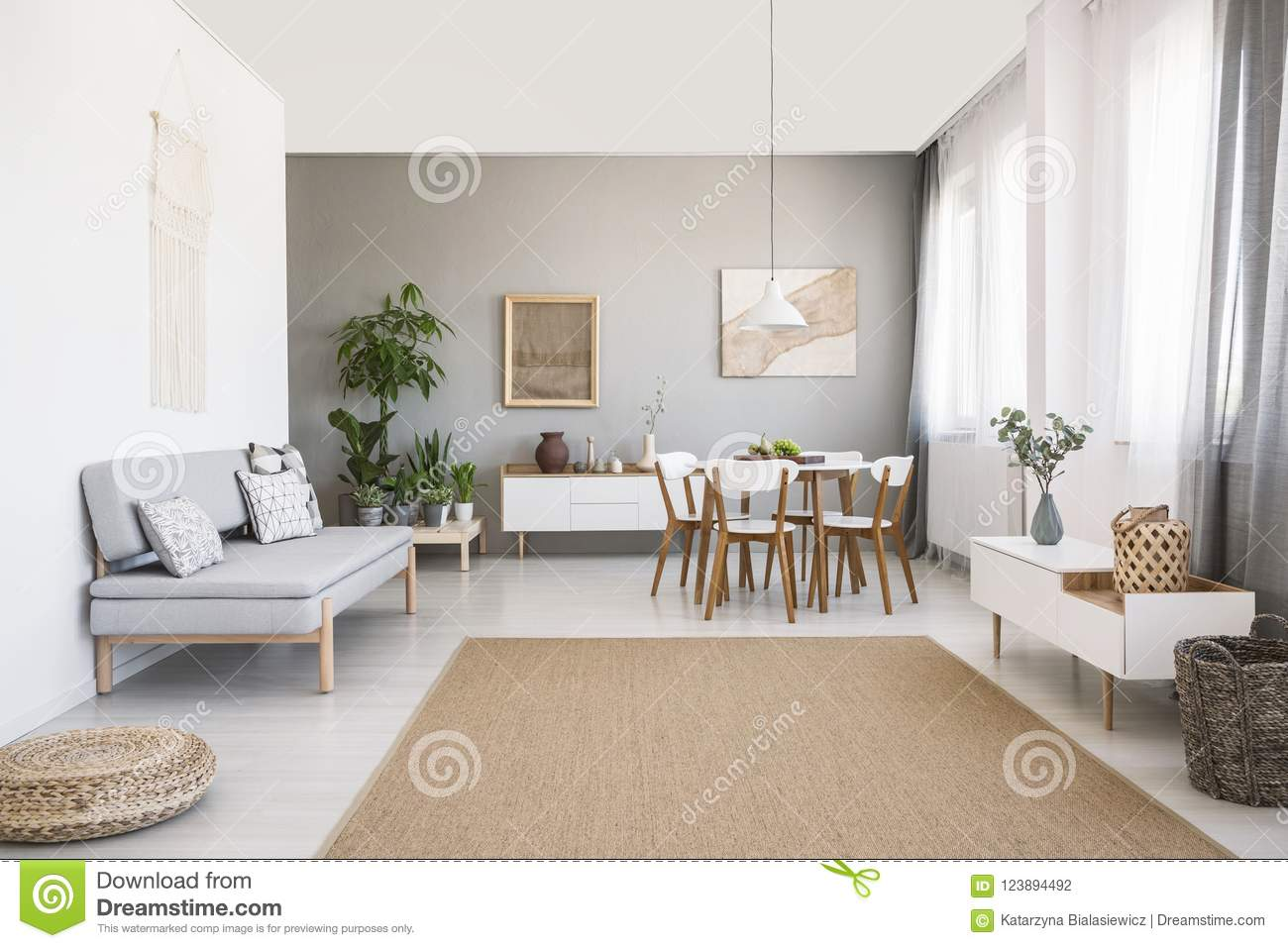 Living Room With Grey Sofa Grey Sofa Near White Chairs At Dining Table In Bright Living Room