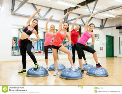 Group Of Female Doing Aerobics With Half Ball Stock Image ...