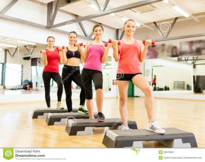 Group Of Smiling Female With Dumbbells And Step Stock ...