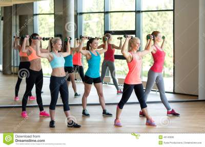 Group Of Women With Dumbbells In Gym Stock Image - Image ...