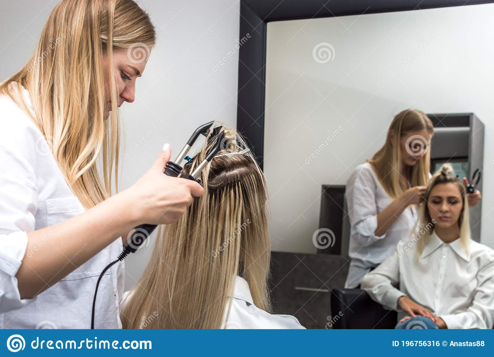Hair Extension For A Client By A Hairdresser In A Beauty Salon Stock Photo Image Of Mirror Tails 196756316