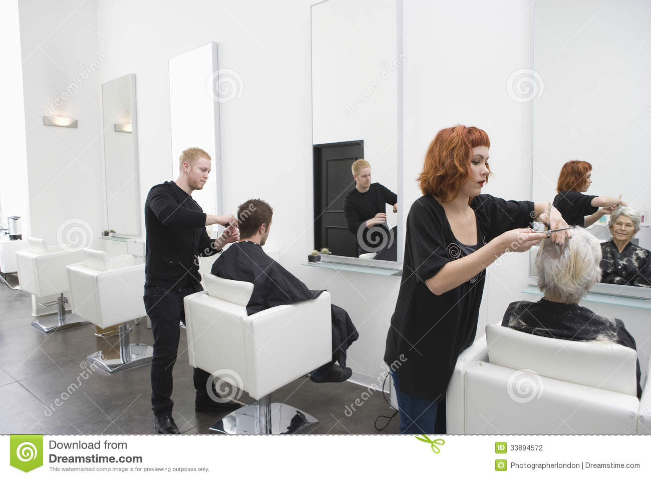 Salon De Depilacion Hairdressers Giving Haircut To Customers Stock Photography