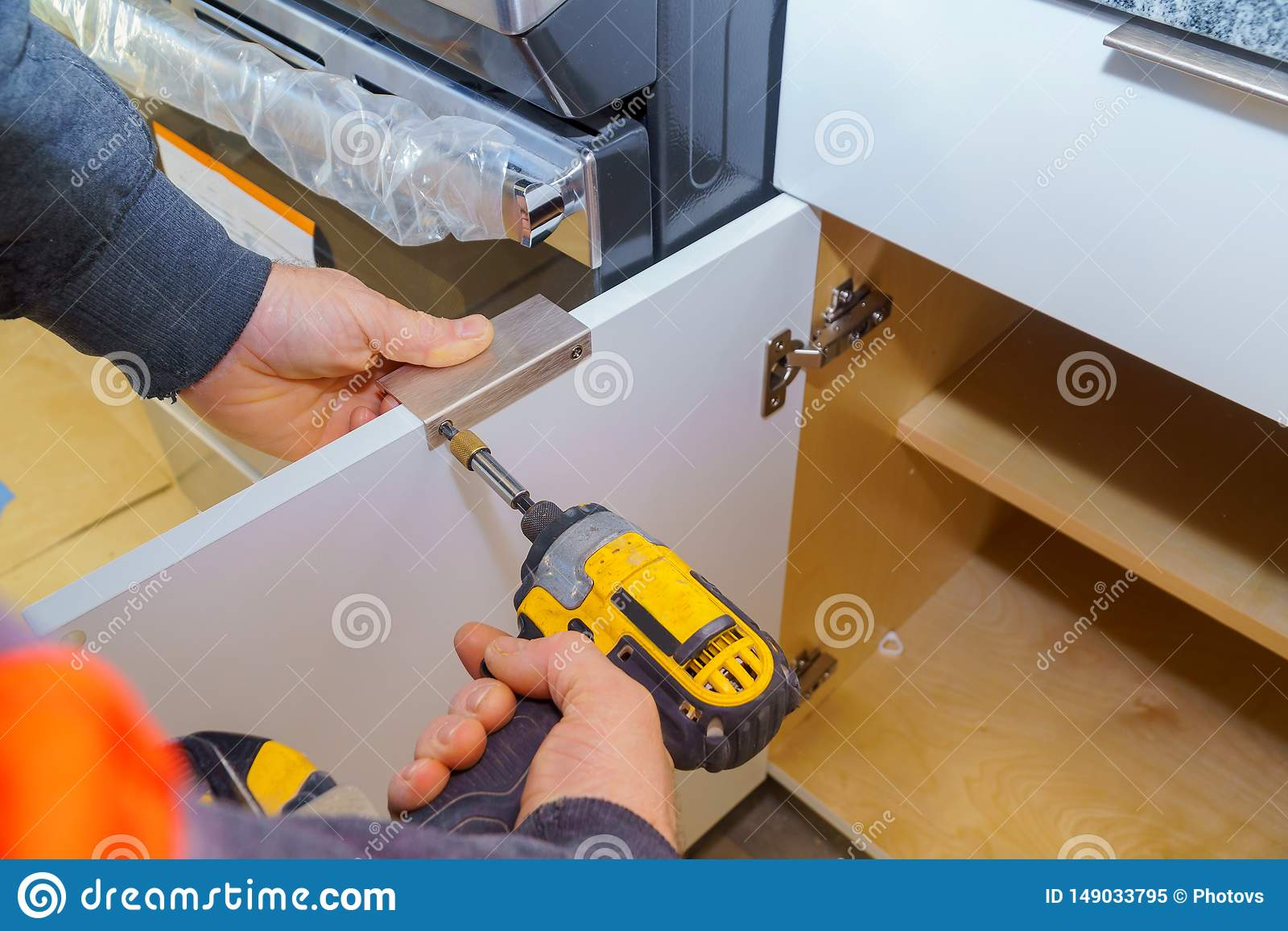 Hand On Handle Installation Door In Kitchen Cabinet Stock Image Image Of Adjustment House 149033795