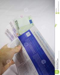 Hand Holding Tax Free Envelope With Thousands Of Euro ...