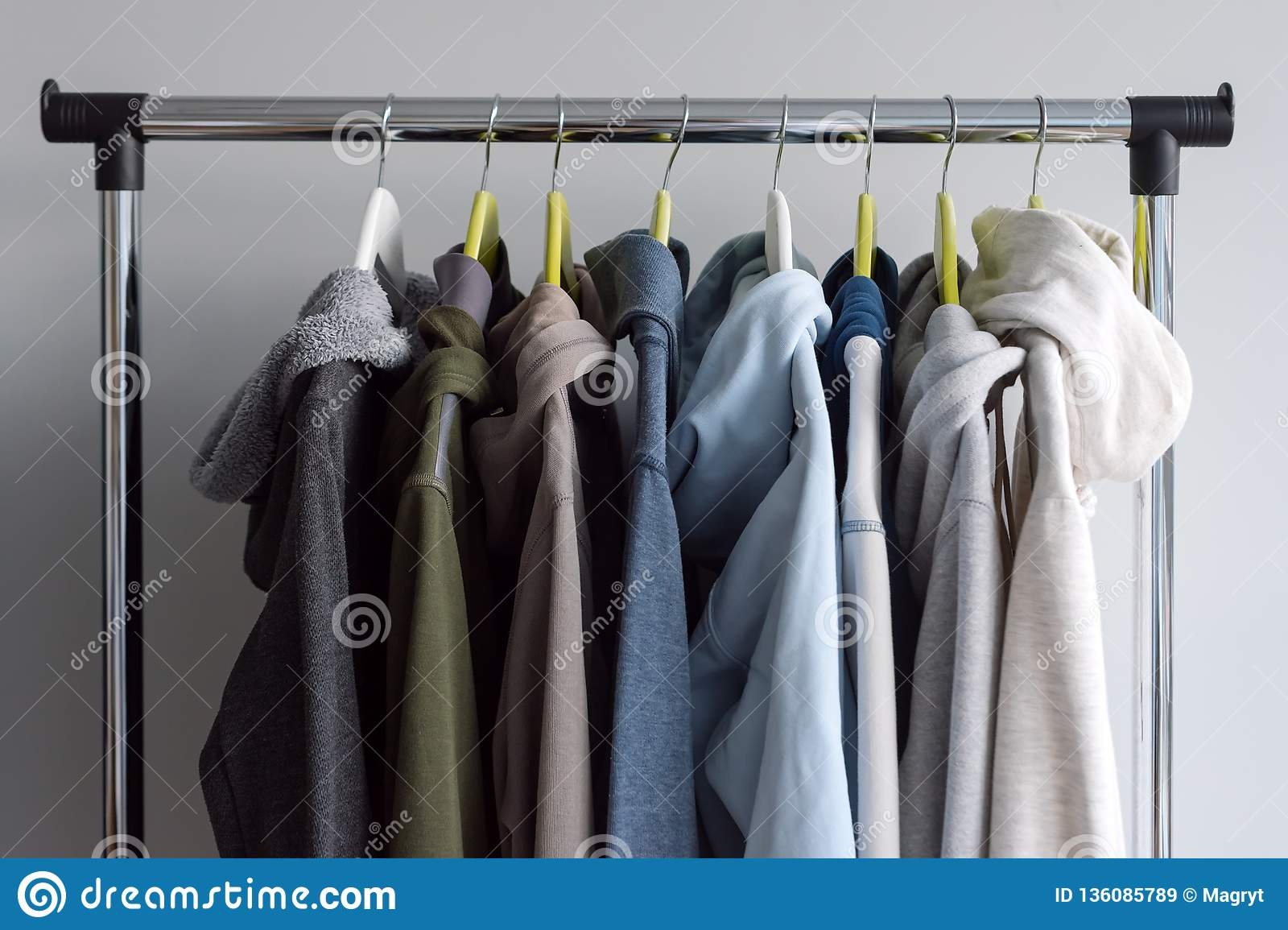 Cloth Hanger Stand Hanger Stand With Spring Or Autumn Warm Clothes On Grey Background