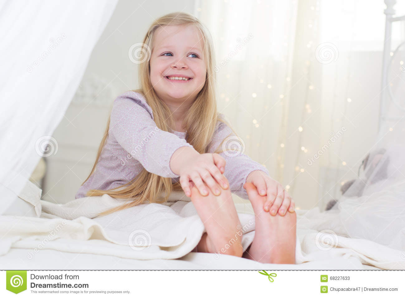 Happy Child Girl Is Sitting In The Bed Good Morning Stock