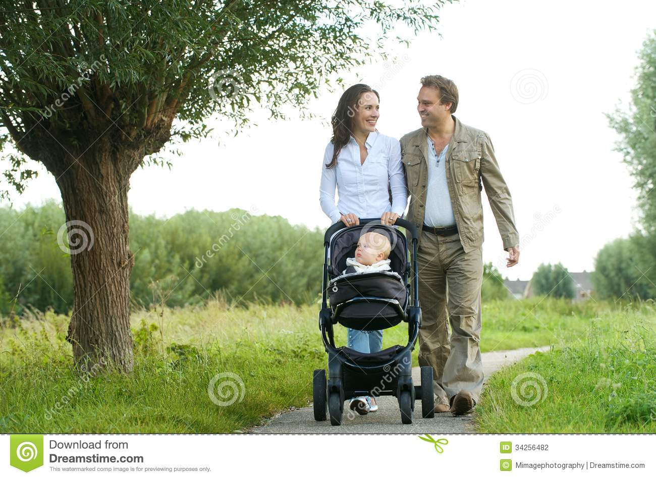 Baby Pram For Newborn Happy Mother And Father Walking With Baby In Pram Stock