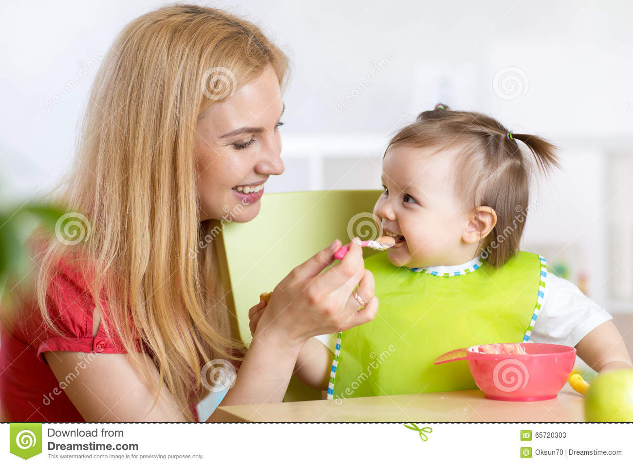 Baby Feeding Spoons Happy Mother Spoon Feeding Her Baby Child Stock Image