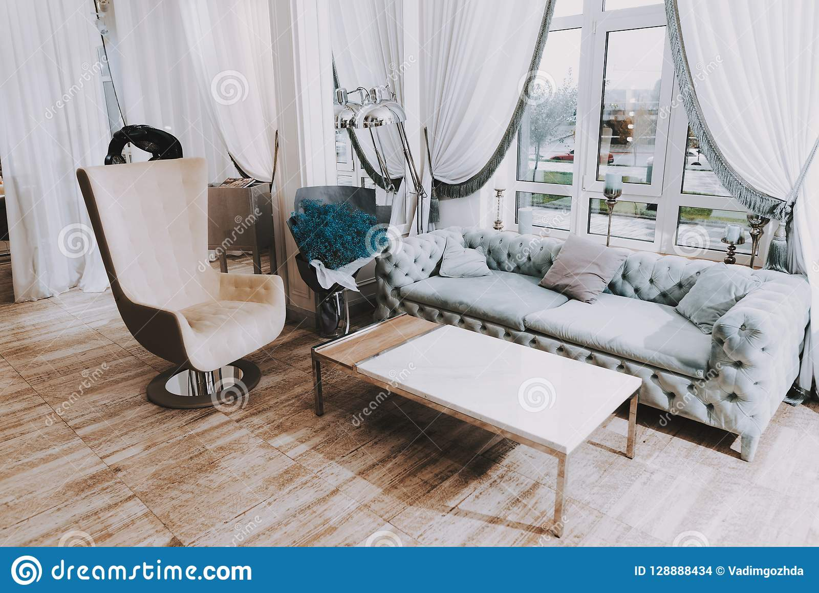 Sofa W Salonie Holl With Blue Sofa And Big Window In Beauty Salon Stock Photo