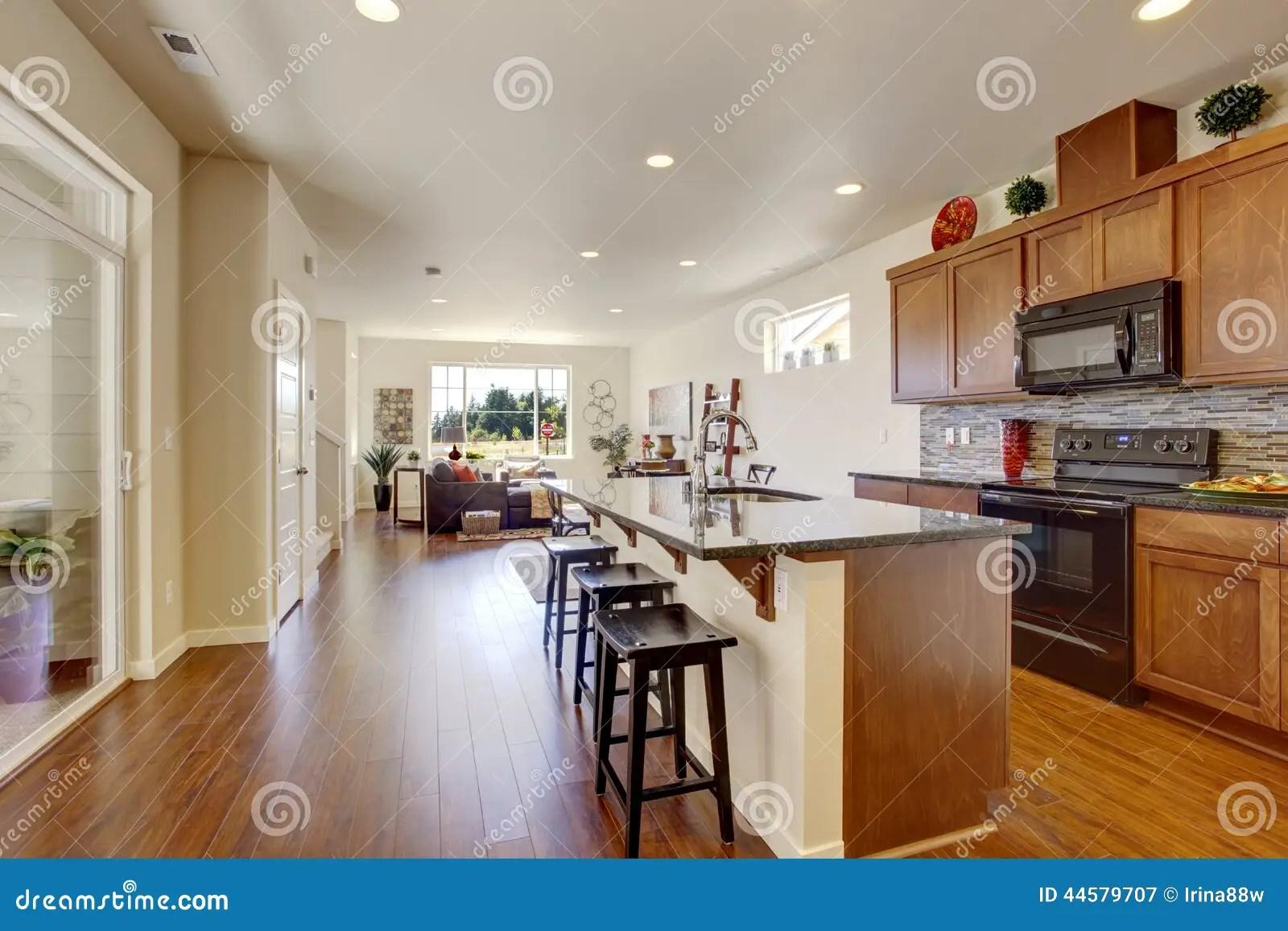 house interior open floor plan kitchen room wiht island bright tile back splash trim 44579707