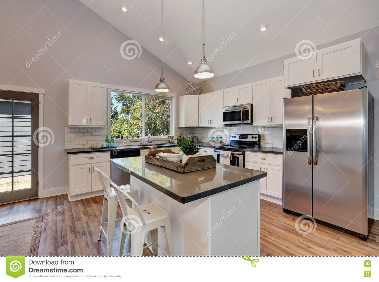 Pendant Lighting For High Ceilings Interior Of Kitchen Room With High Vaulted Ceiling Stock