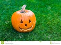 Jack-o-lantern On Green Grass Stock Photo - Image: 35888068