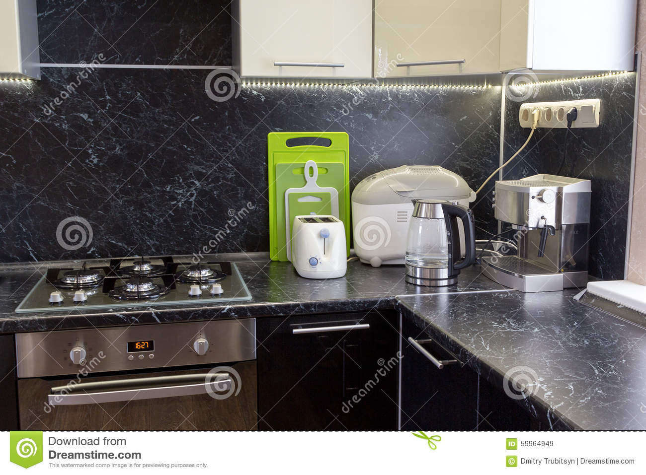 Cucina Kitchen Appliances Kitchen Appliances On Black Worktop With Led Backlight Stock Image