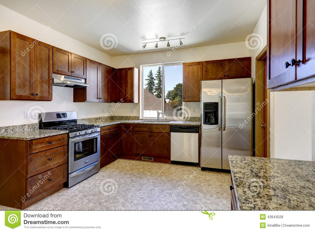 Bright Kitchen Cabinets Kitchen Cabinets With Granite Tops And Ss Appliances Stock