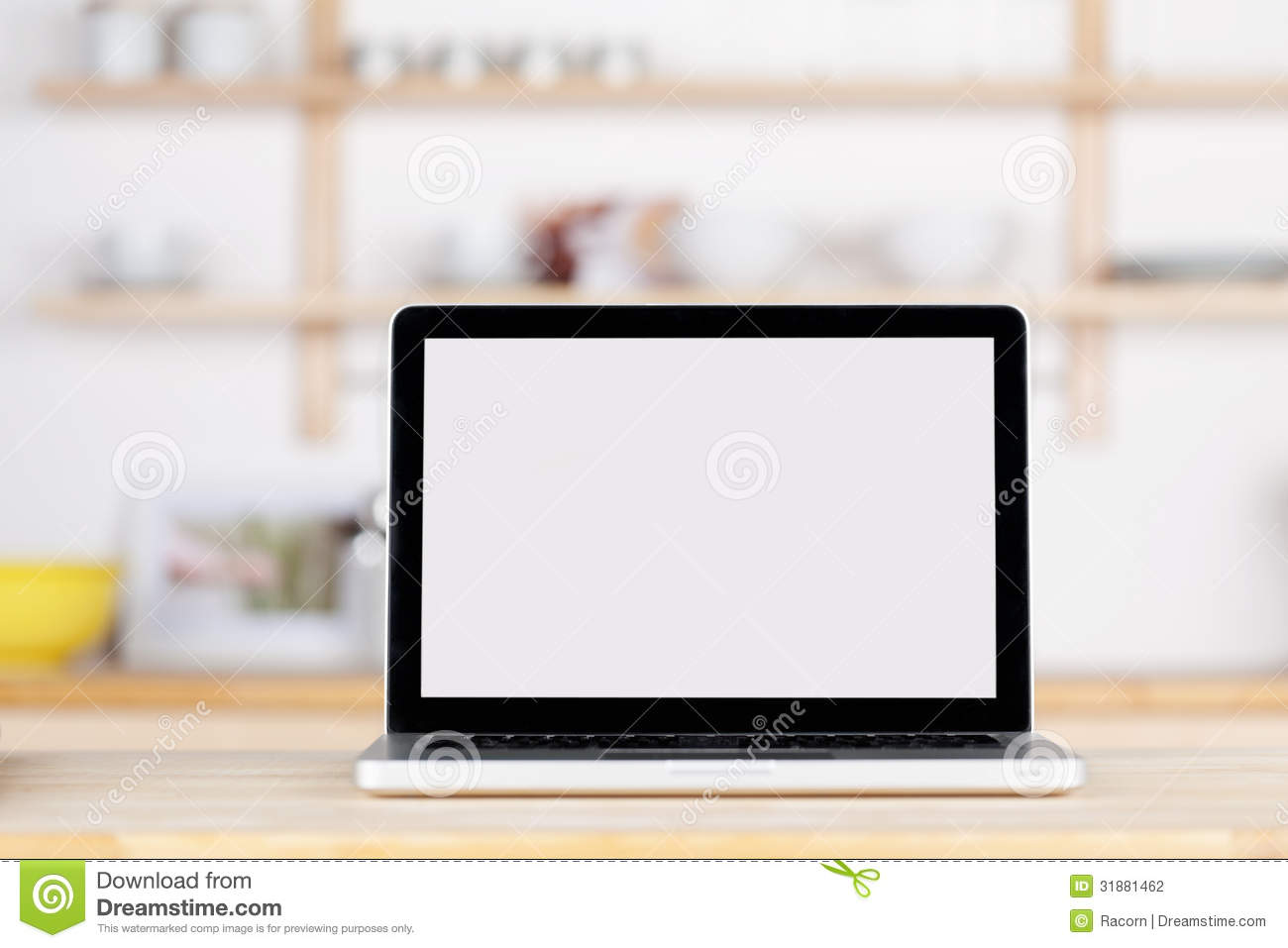 Closeup of laptop with blank screen on kitchen counter