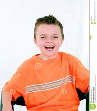 Laughing Little Boy In Chair Royalty Free Stock Photo ...