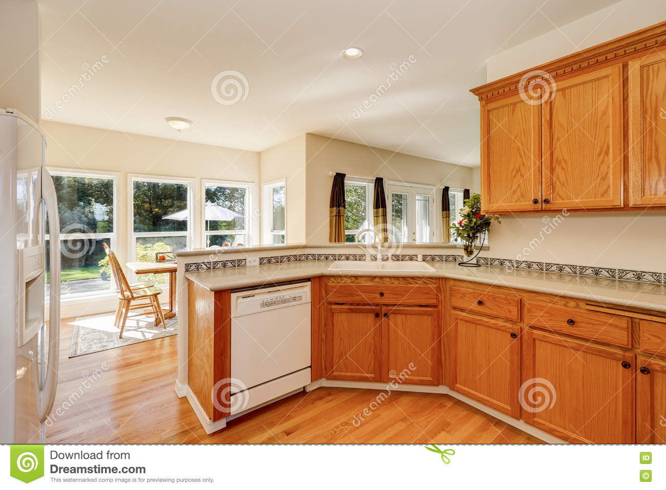 Brown Kitchen Cabinets With White Appliances Light Brown Kitchen Cabinets And White Appliances Stock