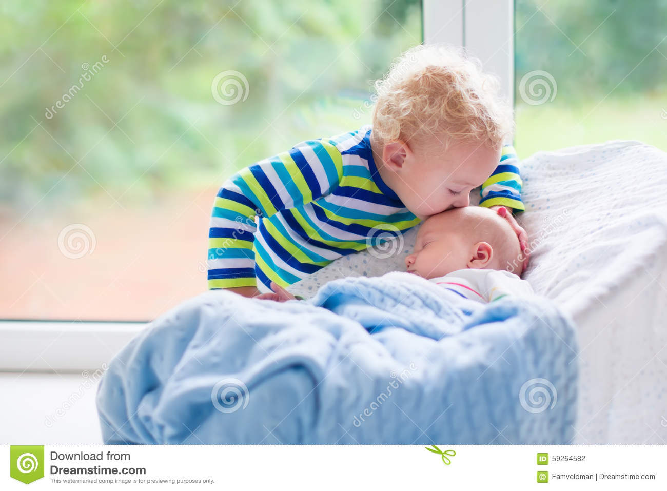 Toddler Baby Bouncer Little Boy Kissing Newborn Baby Brother Stock Photo
