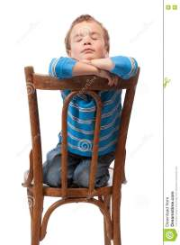 Little Boy Sits In Chair With His Eyes Closed Stock Photos ...