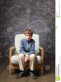 Little Boy Sitting On Chair In Studio Stock Image - Image ...