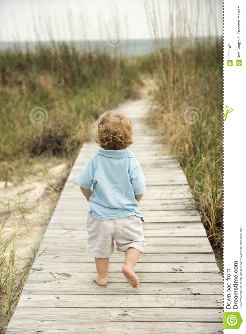 Baby Toddler And Town Little Boy Walking Down Beach Walkway Royalty Free Stock