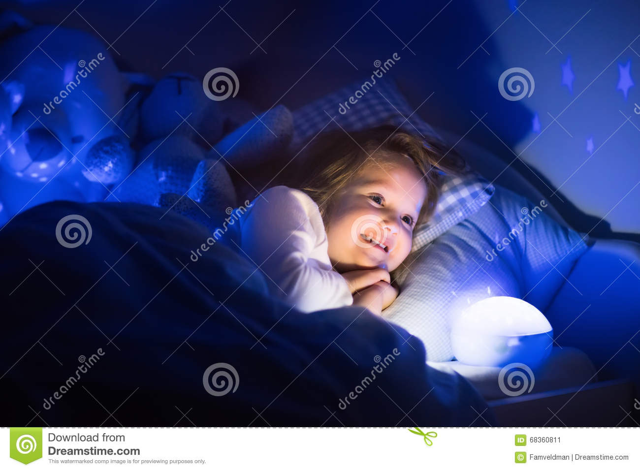 Red Night Light For Nursery Little Girl Reading A Book In Bed Stock Photo Image