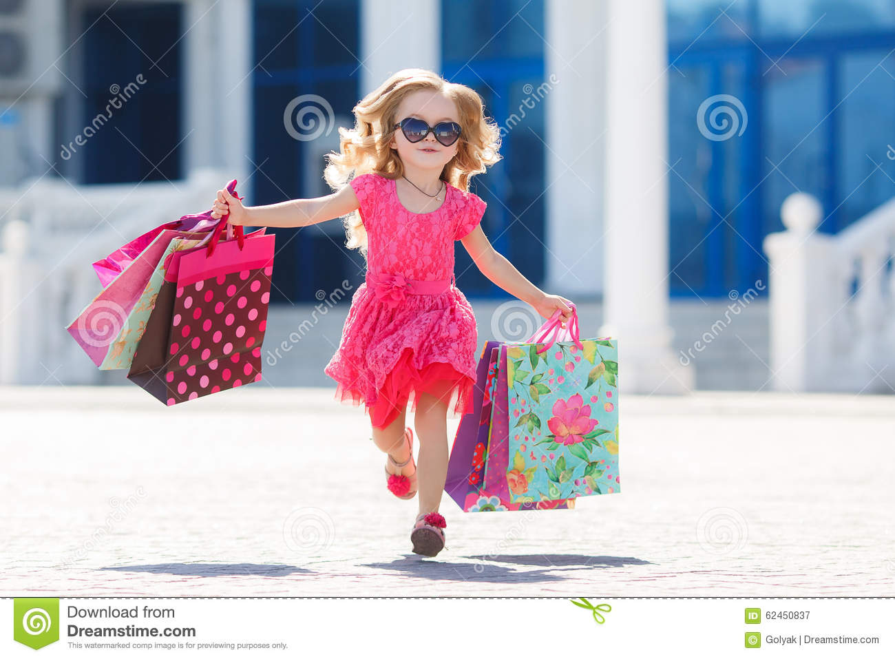Cute Stylish Child Girl Wallpaper Little Girl With Shopping Bags Goes To The Store Stock
