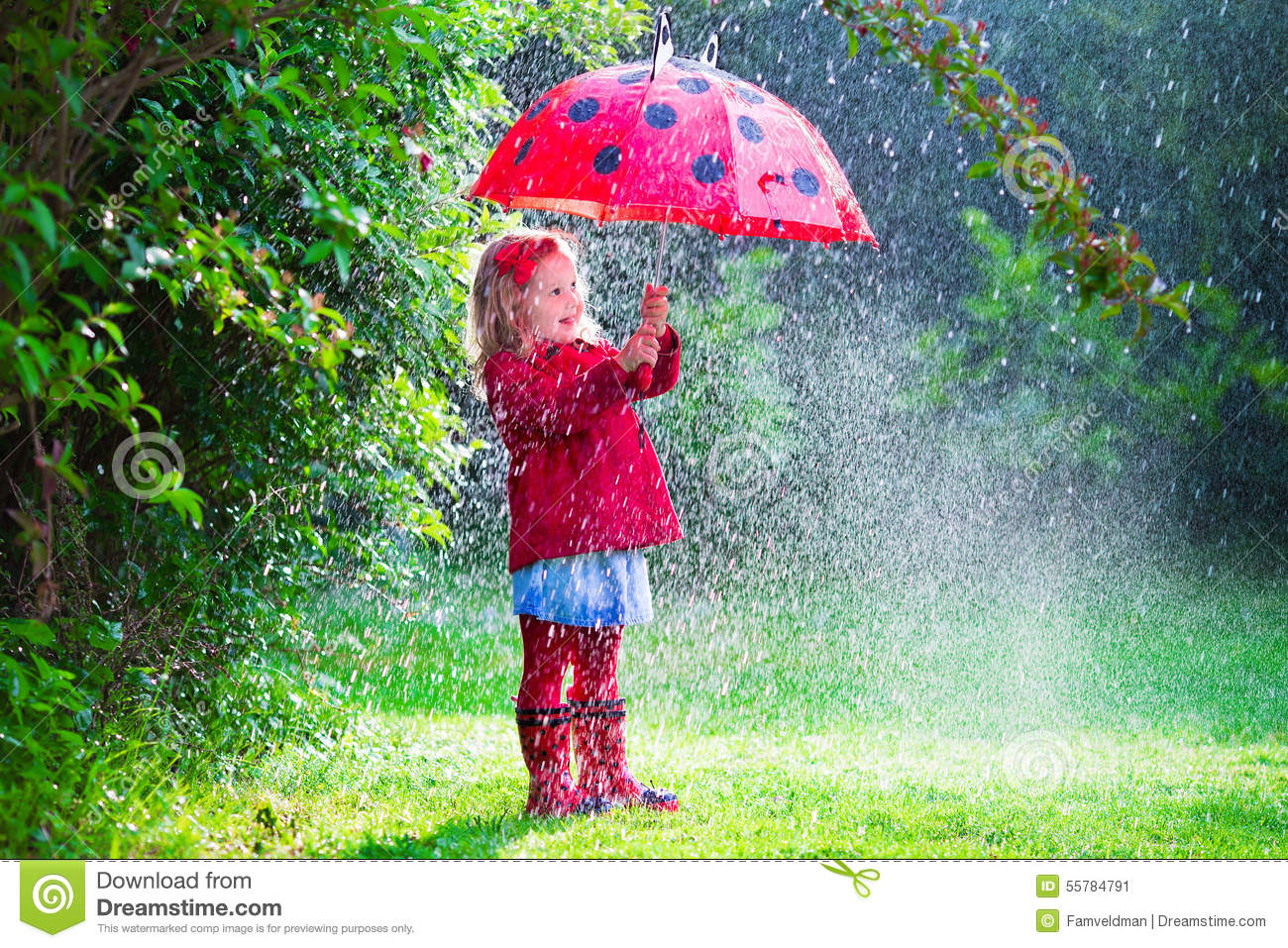 Rainy Fall Day Wallpaper Little Girl With Umbrella Playing In The Rain Stock Photo