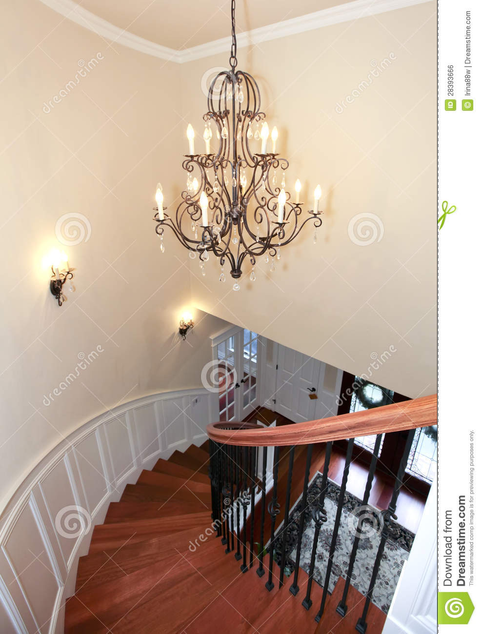 Leuchter Modern Luxury Curved Staircase With Chandelier And Harwood. Stock