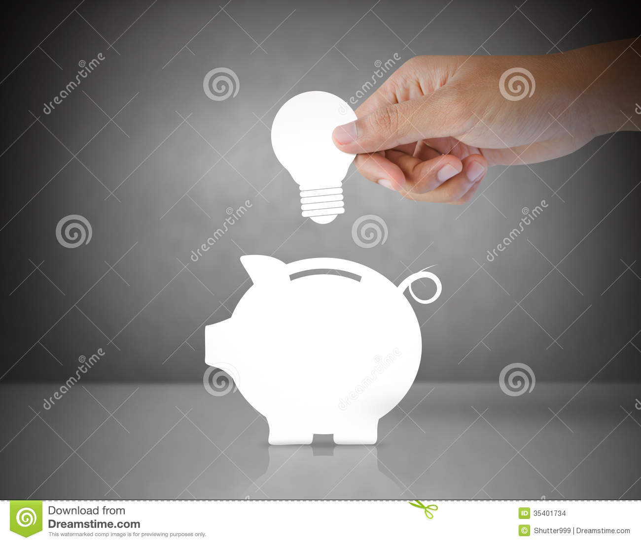 Piggy Bank Idea Male Hand Putting Light Bulb Into A Piggy Bank Stock