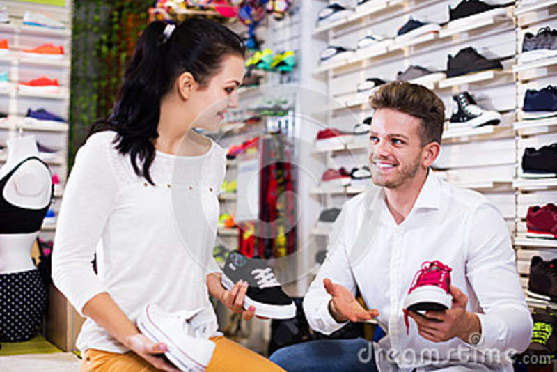 Male Shop Assistant Helping Customer Stock Image - Image of footwear