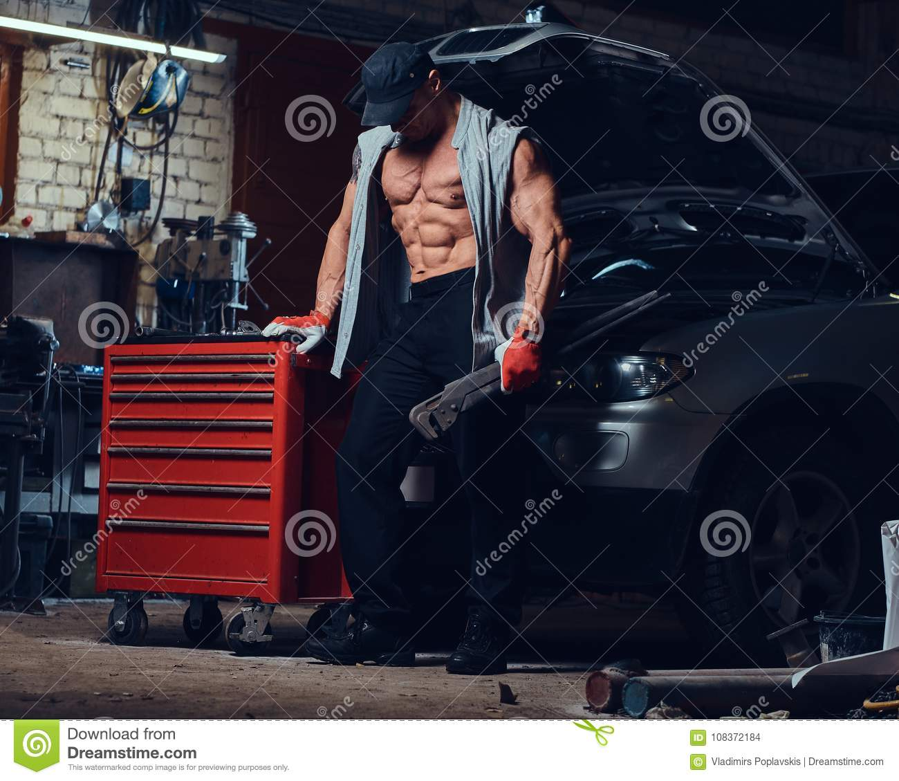 Garage Gym With Car A Man In A Garage Stock Photo Image Of Mechanic Macho 108372184