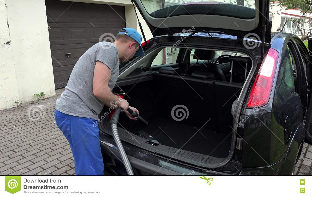 Garage Hoover Vacuum Man Hoover Car Boot With Vacuum Cleaner Stock Video Video Of