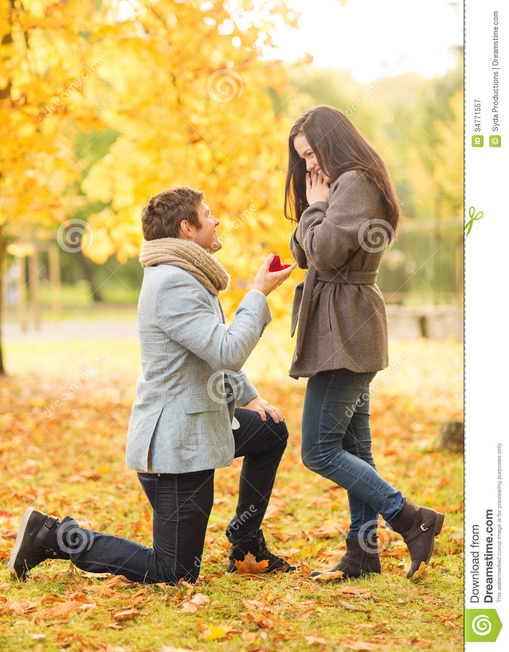 Girl Propose To Boy Wallpaper With Quotes Man Proposing To A Woman In The Autumn Park Stock Image