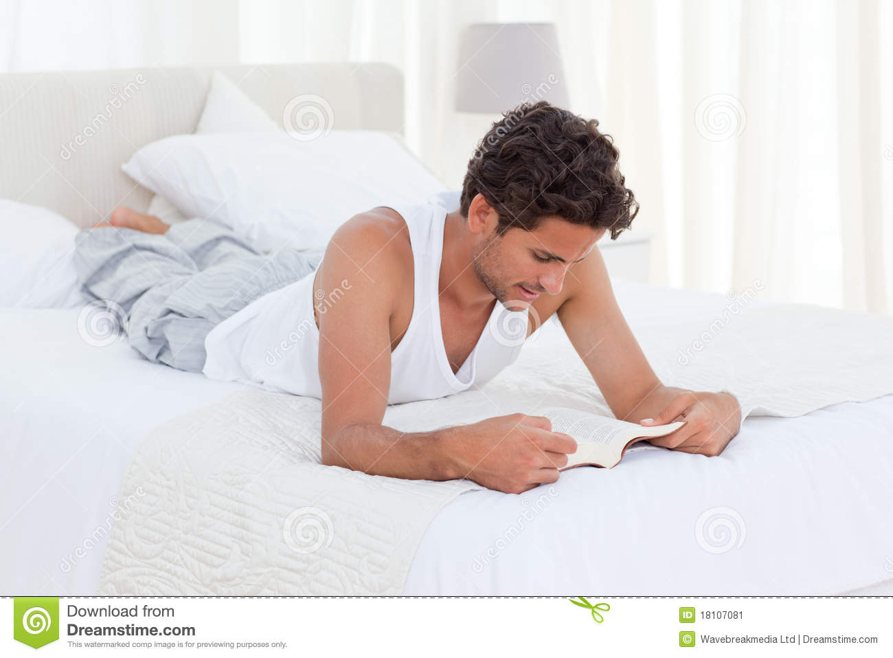 How To Be More Confident In Bed Man Reading A Book On His Bed Stock Image Image 18107081
