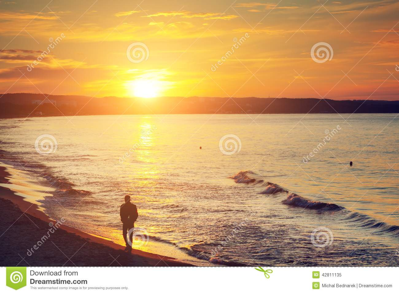 Alone Quotes Wallpaper Free Download Man Walking Alone On The Beach At Sunset Calm Sea Stock