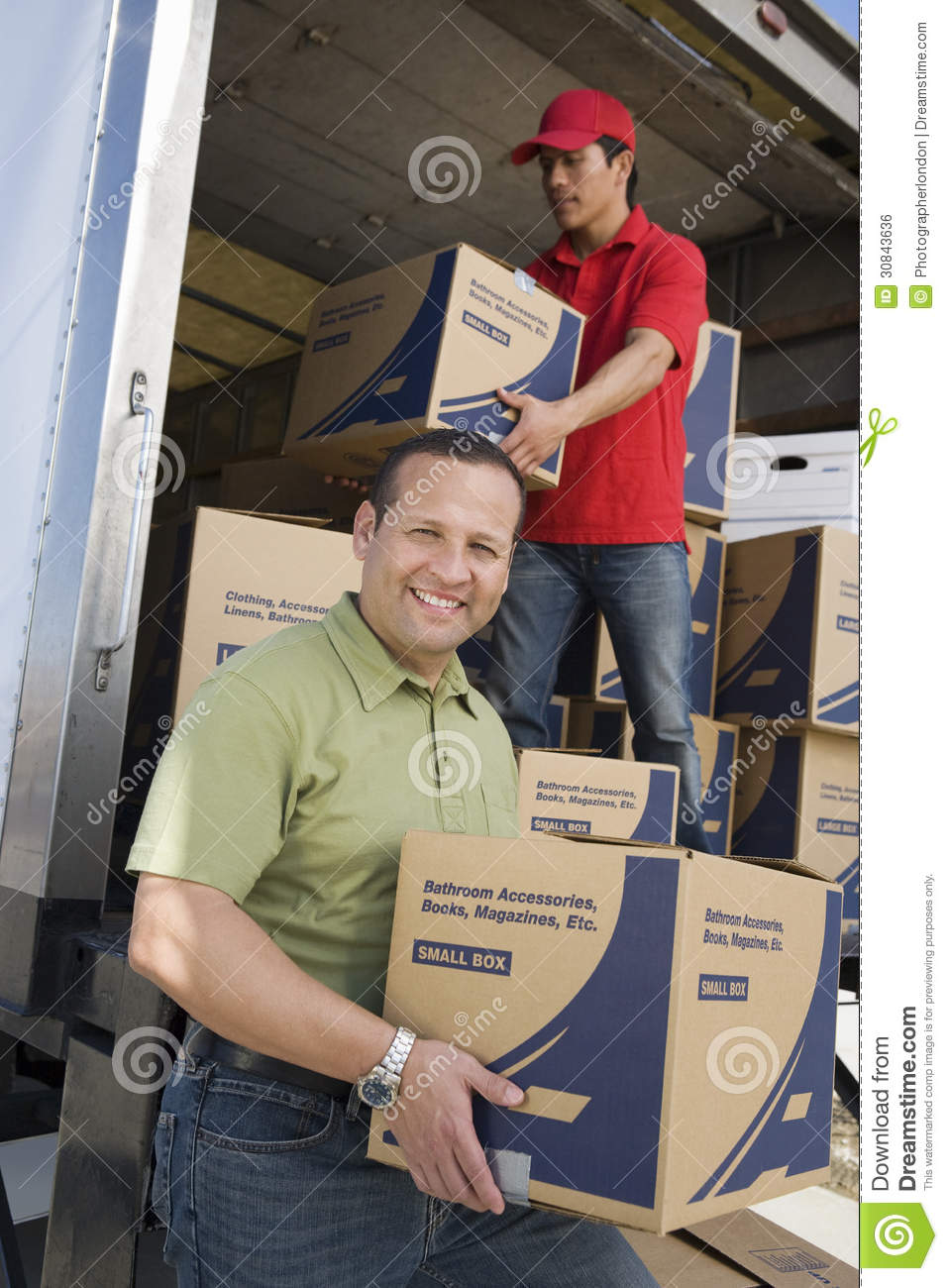 Muebles House Man With Worker Unloading Truck Of Cardboard Boxes Royalty