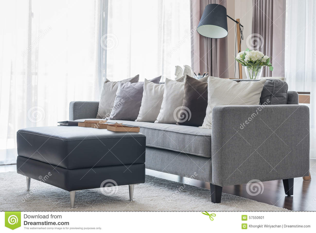 Wohnzimmer Modern Pastel Modern Grey Sofa With Pillows And Black Table In Living Room Stock