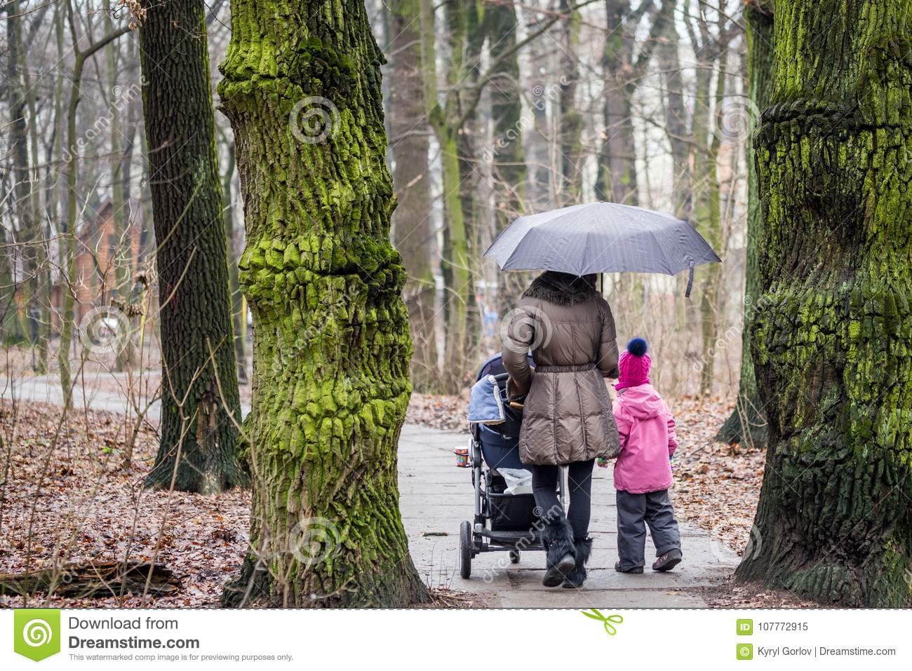 Newborn Umbrella Stroller Mom And Daughter Walking Together With Stroller Stock Image