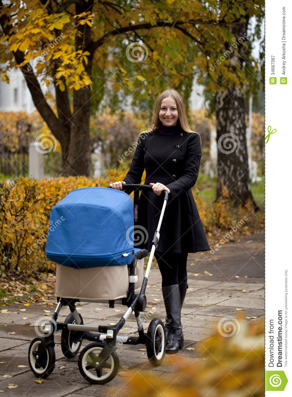Carriage Pram Stroller Mother With Baby Stroller For A Newborn Stock Image