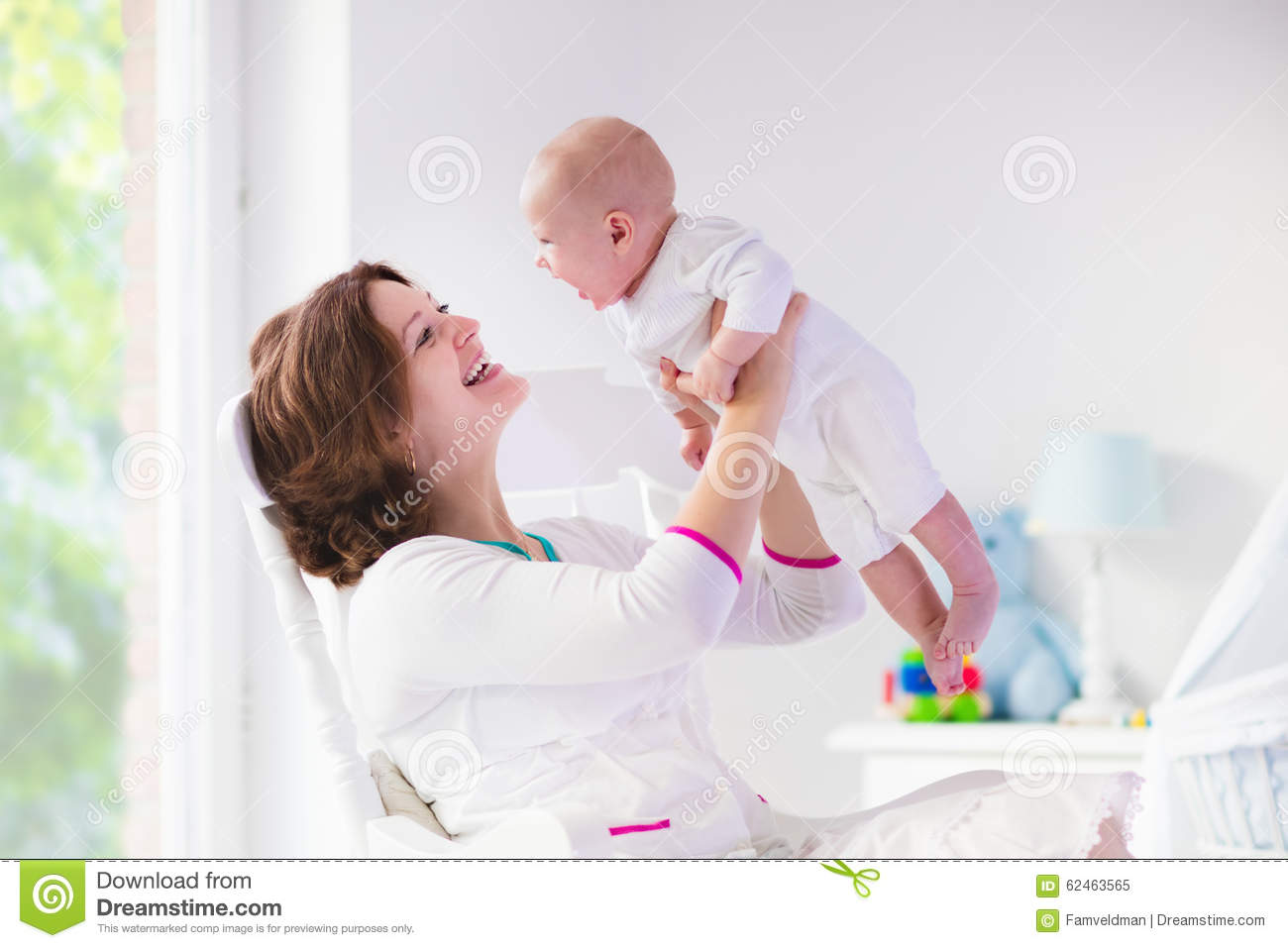 Blue Nursing Chair Mother And Baby In White Bedroom Stock Image Image Of