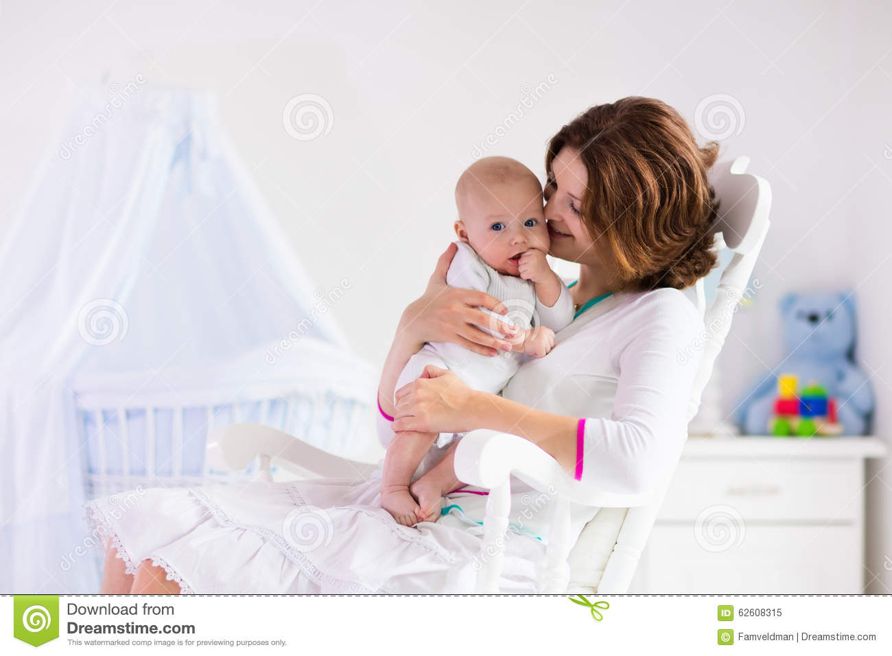 Blue Nursing Chair Mother And Baby In White Bedroom Stock Photo Image 62608315