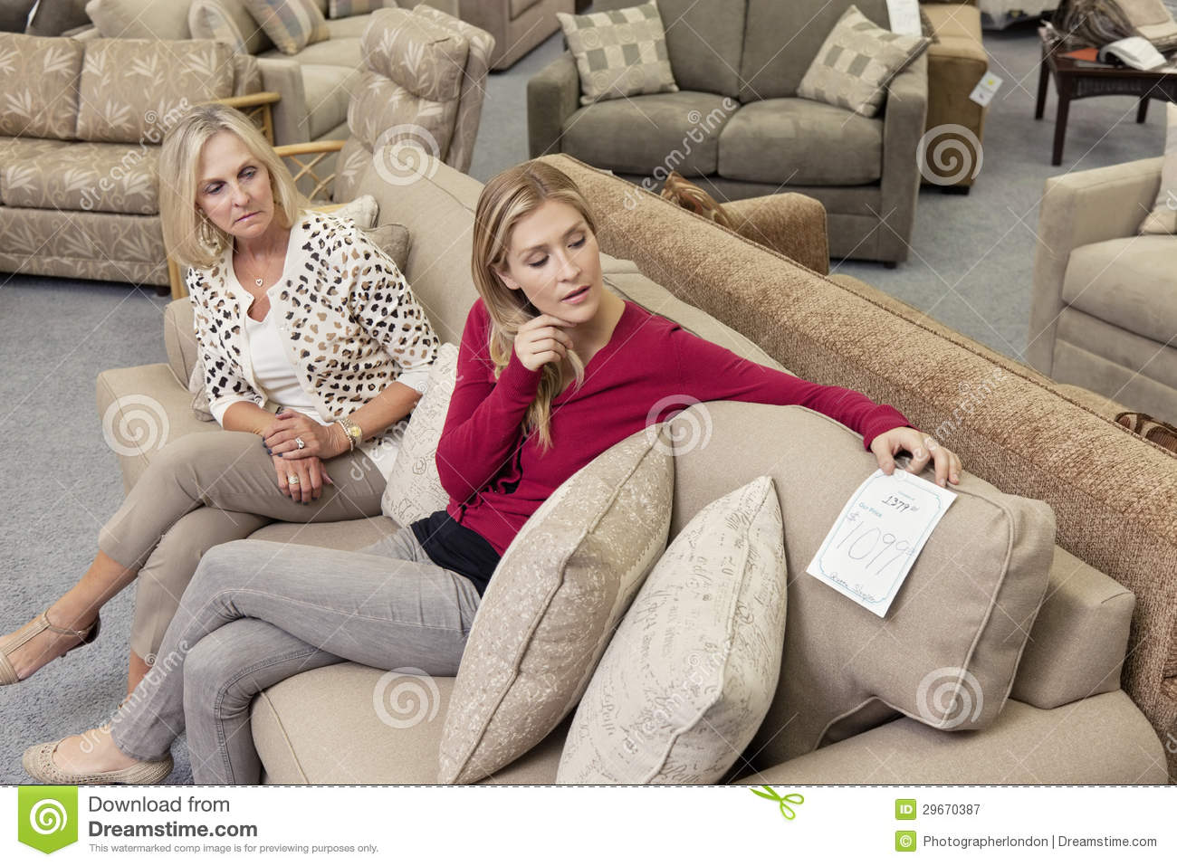 Looking For Chairs Mother And Daughter Sitting On Sofa While Looking At Price
