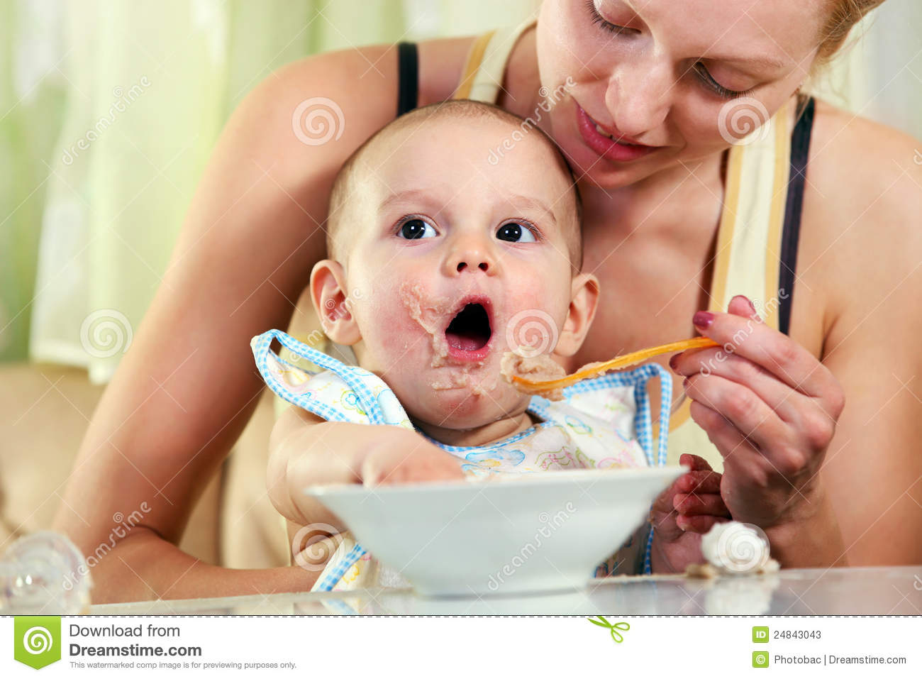 Baby Feeding Spoons Mother Feeding Baby With Spoon Stock Photos Image 24843043