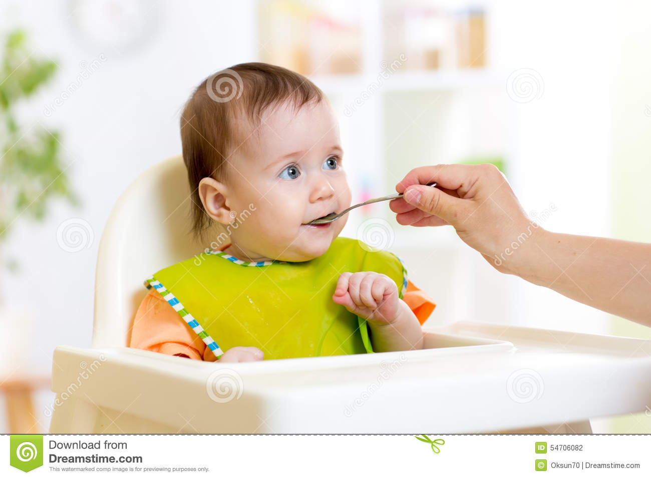 Baby Feeding Spoons Mother Feeding Baby With Spoon Stock Photo Image 54706082
