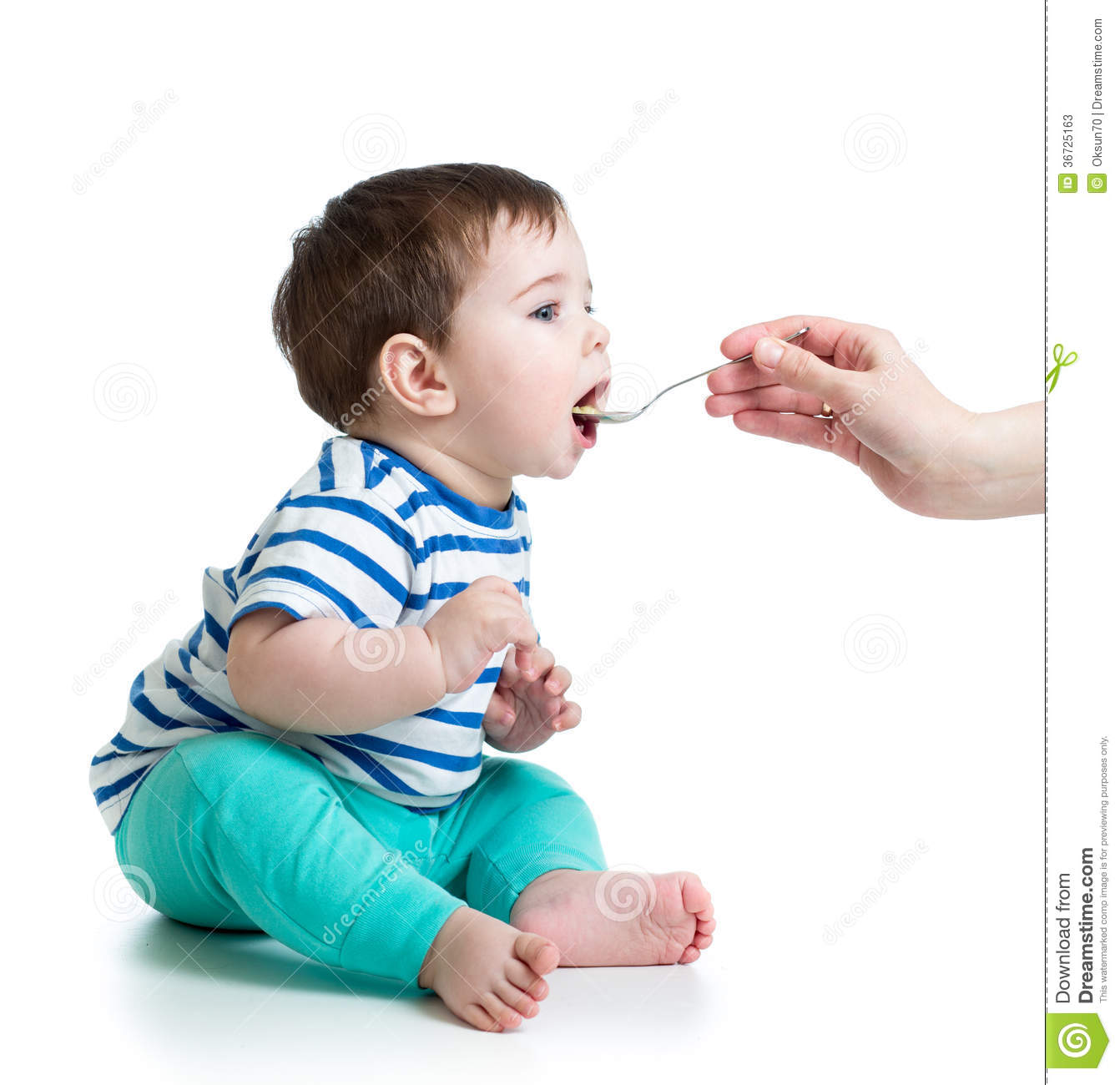 Baby Feeding Spoons Mother Feeding Baby With A Spoon Stock Photos Image