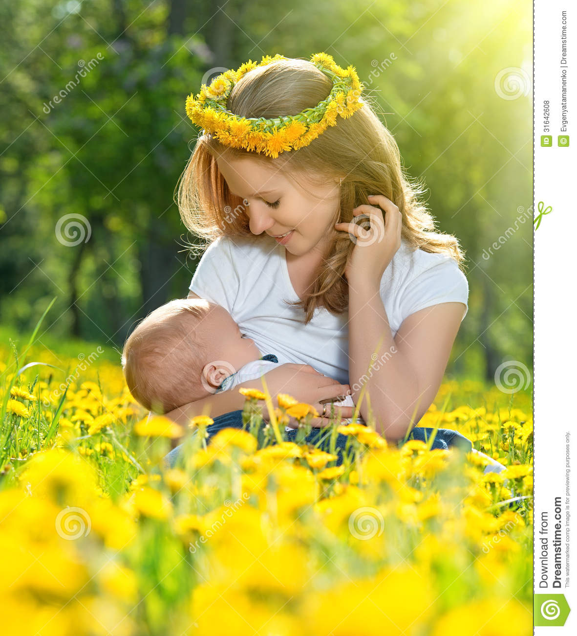 Toddler Kissing Newborn Mother Feeding Her Baby In Nature Green Meadow With Yellow